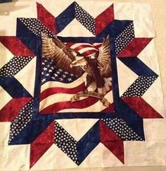 Carpenter's Star with panel in the center. Pattern on Craftsy: https://www.craftsy.com/quilting/patterns/american-pride/206130 . Several nice online free downloads as well for the Carpenter's Star pattern.