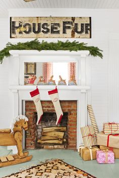 Vintage stockings, a simple evergreen garland, and some retro paper Christmas decorations are all this farmhouse mantel needed to dress up for the season.