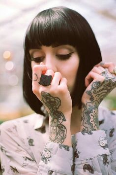 Hannah Snowdon has amazing hand tattoos and a cute dog print top x