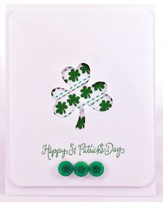 handmade St. Patrick's Day card ... clean and simple ... negative space shamrock backed with shamrock print paper ... green buttons and a green sentiment ...