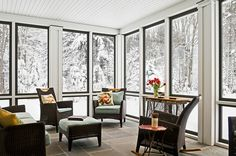 Embrace the outdoors while staying sheltered from the elements with a bright, lounge-ready sunporch