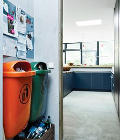 Bring In the TrashWith an eye for the industrial, Winterhalder built the garbage area in the kitchen around two standard-issue plastic trash cans common in German cities. One is orange; the other, green. These in turn inspired her to start adding color accents around the house.  Photo by Mark Seelen.