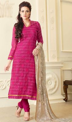 Magenta Chanderi Silk Churidar Kameez Bring out the burst of ethnic factor draped in this magenta chanderi silk churidar kameez. The wonderful lace and resham work across attire is awe-inspiring.  #SilkChuridarKameez #CottonChuridarSuits