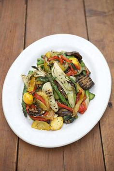 This recipe is about celebrating seasonal veg; cooking them simply on a barbecue or griddle pan then dressing them with a few clever ingredients to really bring out the natural flavours and compliment that smokiness from the cooking process. You can vary the veg if you want to – just cut it all up so that it'll be a pleasure to eat. This is ideal for a light lunch served with grilled fish or meat, or treated as a warm salad in part of a bigger spread.