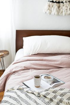 It's #CyberMonday!  I'm prepping to tackle my holiday list from bed today, but first: tea and my favorite cookbook in the coziest spot in our house.  Ahhhh, heaven!  If you're looking to up your hygge game, pop over to @SertaMattress to scoop up some Cyber Monday bedroom accessory deals!  Let's get cozy this holiday season!  #sponsored