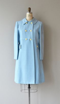 Vintage 1960s lightweight spring coat in baby blue coat with white double breasted buttons and acetate lining.  --- M E A S U R E M E N T S ---  fits