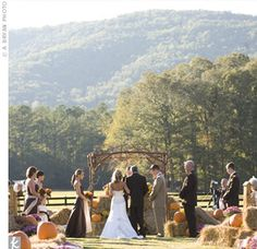 Elena and Adam said their vows with lush green mountains as their backdrop just as the sun began to set. Pumpkins and bales of hay lined the aisle to the altar, where Elena's dad, a minister, performed the ceremony.