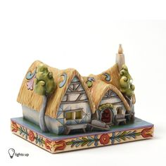 Title: Enchanted Cottage Introduction: June 2012 Item Number: 4031495 Dimensions: 4.875 x 4.5 x 6.375 inches Weight: 1.80 lb The dwarf's' cottage from Snow White and the Seven Dwarfs is truly an encha