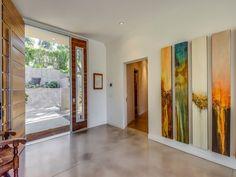 Entry with tall art | Chris Hemsworth and Elsa Pataky  Malibu Home