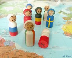 Flag Peg People - Way to Expensive but a really neat Idea. I would love to have/make a world set of them.