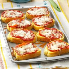 Garlic Toast Pizzas Recipe -Between working full-time, going to school and raising three children, finding time-saving recipes that my family likes is one of my biggest challenges. These quick pizzas pack a huge amount of flavor. —Amy Grim, Chillicothe, Ohio