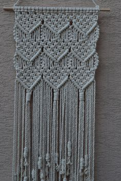 Wall panels handmade macramé technique. Material: 100% cotton. Color: white. Strap: natural wood - pine. Dimensions: The length of the strap to the bottom, including the thread - 105cm / 41,3 inches The width of wall hanging - 40cm / 15.7 inches