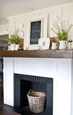 Brick fireplace makeover-- love the wood mantle top Fireplace Redo, Faux Fireplace, Fireplace Remodel, Fireplace Makeovers, Simple Fireplace, Cottage Fireplace, Fireplace Design, Unused Fireplace, Black Brick Fireplace