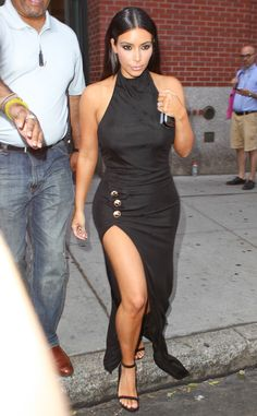 Best Leg Forward from Kim Kardashian's Mommy Style Kim covers up the cleavage and lets her leg shine for a night out in NYC.