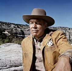 """George Kennedy. Famous for his """"big guy"""" roles. Outstanding supporting parts in movies such as Airport and Best Supporting Actor for his famous role in Cool Hand Luke, but I remember his almost cameo as the hired gunslinger up against John Wayne in Sons Of Katie Elder."""