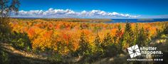 Autumn Vistas of Nicolet Bay by Mark David Zahn Photography (formerly Shutter Happens Photography).  Fall colors spill down the bluffs of Peninsula State Park near Fish Creek Wisconsin, towards Nicolet Bay on the Bay of Green Bay.  In the distance, Horseshoe Island mirrors the gorgeous autumn hues of the Door County peninsula.  The overlook off the park's Skyline Drive offers panoramic views over the bay, and is one of Door County's premiere spots for color viewing.