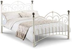 This Isbar Stone White/Brass 6 Double Bed Frame Isbar is a timeless classic style metal bed frame with ornate castings, finished in Stone White with Brass Plated Finials. Material: Powder Coated Steel With Brass P