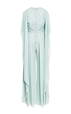 Rendered in a mint green-color, this striking silk georgette **Elie Saab** jumpsuit features an embroidered V-neck bodice with wide cape sleeves wide leg trousers.