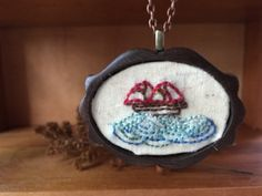 #Jewelry  #Necklace  #Fiber # thehornet'snest  #hand embroidered  #needlework  #wood #jewelry #pendant  #gift  #christmas gift #sweet   #ship waves  #nautical jewelry  #sailing ship  #ship in a bottle  #embroidered #ship