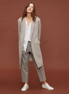 Cozy up to a fine-tailored wool coat.