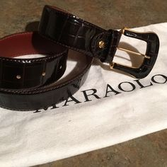 SOLD !!! AS A BUNDLE WITH BAG ,ITALIAN BELT&BUCKLE Maraolo, vintage dark rich brown belt. With heavy gold tone buckle. With no cracking or breaking and in very good shape.This beautiful Italian made belt has never been worn . The belt is 32in. long and fully lined. Comes with dust bag. Maraolo Accessories Belts