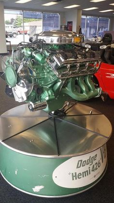 A Beautifully displayed Chrysler 426 HEMI. Though green was never a production color this remains the BEST display I've ever seen hence; Hemi Engine, Car Engine, Diesel Engine, Dodge Muscle Cars, Automobile, Performance Engines, Race Engines, Best Classic Cars, American Muscle Cars