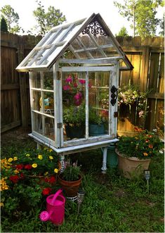 Backyard greenhouse made from old windows. | back yard ideas | old window decor | garden inspiration | DIY greenhouse |