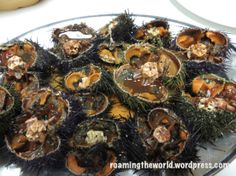 #Oddities  Strange foods: Oricios, Gonads of Sea Urchins are eaten in China, Japa, Spain and Italy.  They are animals (their flesh squirm when you cut them opened like rambutans!)  In China eggs are poured over the urchin flesh before they are steamed.  Be careful not to prick yourself when eating this!