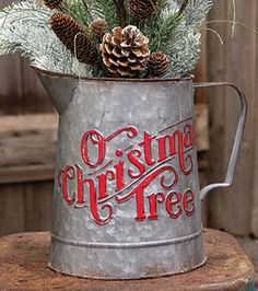 KP Creek Gifts - O Christmas Tree Metal Pitcher. Add a small tabletop tree to this galvanized metal pitcher for a unique holiday display! #holidaydecor #farmhousechristmas #galvanized #christmastree #treeinspiration #DIY #christmasdecorations