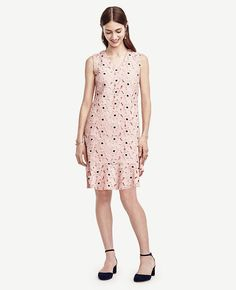 """Clad+in+blossoming+begonias,+delicate+cutouts+and+a+flirty+flounce+hem,+this+cotton+lace+charmer+is+poised+to+be+a+perennial+favorite.+V-neck.+Sleeveless.+Hidden+back+zipper+with+hook-and-eye+closure.+Flounce+hem.+Lined.+21+3/4""""+from+natural+waist."""
