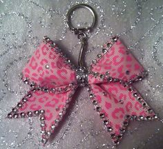 Cheer Bow Keychain Pink Leopard Bling from JustBowItUp on Etsy. Shop more products from JustBowItUp on Etsy on Wanelo. Bling Cheer Bows, Cheerleading Hair Bows, Cheerleading Stunting, Cheerleader Bows, Cheer Hair, Cheer Mom, Ribbon Bows, Grosgrain Ribbon, Cheer Pictures