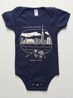 Meera Lee Patel's hand-printed Exclusive Navy Toronto Onesie is the perfect onesie for those Toronto natives. Also available in Charcoal!