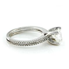 French Micro Pave Double Row Diamond Ring. Stylish double row band with round brilliant diamonds in 18 karat white gold. The basket holding the center diamond is adorned with round brilliant diamonds for a little extra sparkle! 1.84ctw