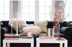 Black sofa, pops of color.