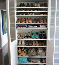 """IKEA Billy shelving for shoe storage - I'm talking about storage needs here, people. Shoes, bags, accessories, clothes – Billy is any closet-challenged girl's dream guy.  The IKEA Billy white bookshelf and Morebo aluminum-framed white glass door combo has a fresh, modern look, and at only 11"""" deep, take up minimal space. You'd be surprised just how much can fit into one of those puppies. You can see them in this post, where I took on a Toss-50-Things Challenge."""
