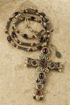 Cross pendant is rich with garnets accented with gold settings and gold scroll work. This exquisite combination makes this pendant a stunning addition to your collection. - Adjustable Beaded Chain Mea