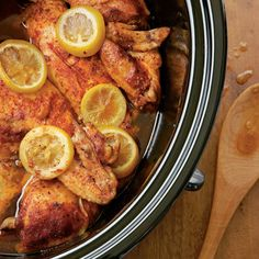 Slow-cooked Barbecued Chicken | Enjoy this slow-cooked chicken by itself or as a sandwich piled with Pickled Peppers & Onions atop Sweet Potato Cornbread. MyRecipes