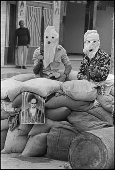 Armed pro-Khomeini militia during the uprising of the Arabic-speaking people masked to prevent identification by Arab neighbours. Iran Khorramshahr May 1979 photo by Abbas Attar Lebanese Civil War, Iran Pictures, Pahlavi Dynasty, The Shah Of Iran, Dark City, Mosaic Garden, Alien Logo, Back To Black, Vintage Photography