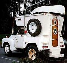 Vintage truck with built on camper, portholes and boat storage/launching