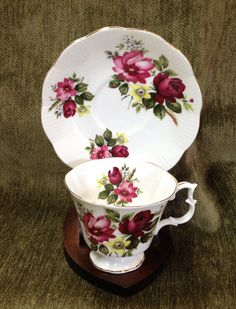 Lovey Royal Albert cup and saucer set. Made of fine bone china in England. The pattern features red roses and yellow and white floral accents. Gold Trim. No chips, cracks, crazing or repairs. Excellent vintage condition.