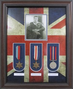 Framed War War 1 medals  with photo and Union Jack matting.