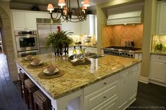 #Kitchen Idea of the Day: Gourmet kitchen featuring a large island with seating.