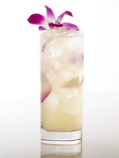 cocktail garnished with purple orchid