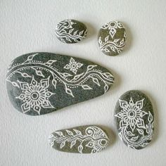 vining lotus painted pebbles by OurFolkLife on Etsy, $59.00