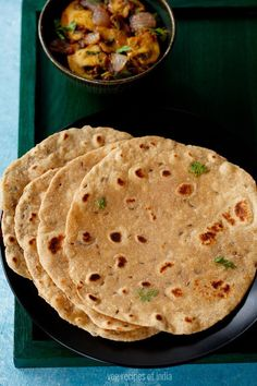 khasta roti recipe - leavened crisp and flaky flat breads made from whole wheat flour, cumin and ghee.