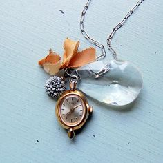 vintage watch face with a charm, crystal facet, etc. to make a great necklace.