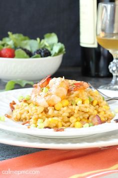 Sweet Corn Risotto with Shrimp Sweet corn adds a nice crunch to creamy risotto, it's topped with sauteed shrimp and salty bacon for a scrumptious dinner.
