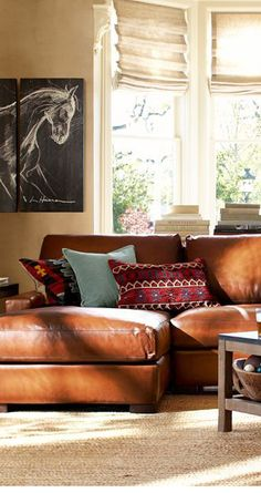 Love the blue and red together on the leather sofa.