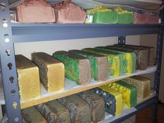 Olive oil soap logs waiting and drying.