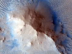Mars. Large Central Uplift of an Impact Crater.